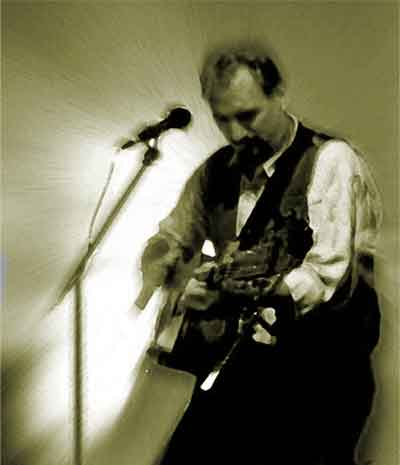 Photo of Todd Samusson performing.